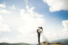 Beautiful gorgeous bride posing to groom and having fun, luxury ceremony at mountains with amazing view, space for text. Wedding couple Stock Image