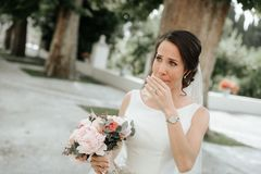 Beautiful gorgeous brunet bride crying at the wedding day