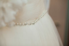 Beautiful gorgeous flower and pearl belt on fabulous wedding dre Stock Photos