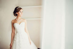 Beautiful gorgeous stylish bride in the morning in Stock Images