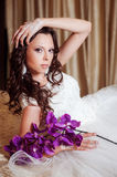 Beautiful gorgeous stylish bride with orchids Royalty Free Stock Photo