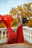 Beautiful gorgeous Woman model in elegant mermaid red dress with Royalty Free Stock Photography