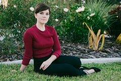 Attractive Cute Female Model with Short Pixie Hair Modeling Outside in Nature stock photo