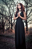 Beautiful goth girl amongst the trees Stock Photos