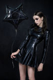 Beautiful goth mistress evil girl. With baloon Royalty Free Stock Image