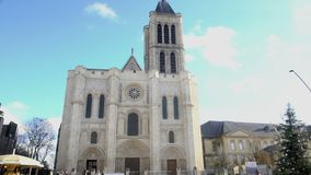 Beautiful gothic church and Christmas tree in Paris, people enjoying recreation. Stock footage stock video