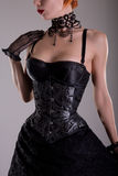 Beautiful gothic girl in silver corset Royalty Free Stock Photography