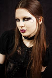 Beautiful gothic girl with swan makeup. Studio work with black background Stock Photography