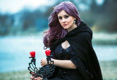 The beautiful gothic girl with sword. The beautiful gothic girl outdoor stock photos