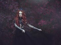 A beautiful gothic princess with pale skin and long red hair wearing a crown and a black dress against the backdrop of burgundy le