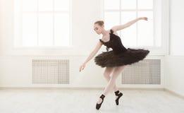 Beautiful graceful ballerina in black swan dress stock photos