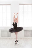 Beautiful graceful ballerina in black swan dress Stock Photography