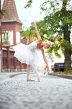 Beautiful graceful ballerina dancing on the streets of an old ci. Shot of a beautiful ballerina dancing sensually on the street of an old beautiful town Royalty Free Stock Image