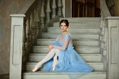 Free Beautiful Graceful Girl Ballerina In A Blue Dress And Pointe Is Royalty Free Stock Photography - 112217497