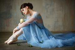 Free Beautiful Graceful Girl Ballerina In A Blue Dress And Pointe Sit Stock Image - 112217461