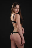 Beautiful graceful slim girl with sexy buttocks in lingerie Stock Images