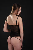 Beautiful graceful slim girl with sexy buttocks in nightwear Stock Image