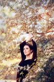 Beautiful Graceful Woman in Spring Blossom Enjoying the Flowers Stock Images