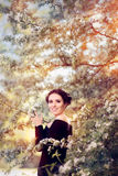 Beautiful Graceful Woman in Spring Blossom Enjoying the Flowers Stock Photography