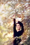 Beautiful Graceful Woman in Spring Blossom Enjoying the Flowers Stock Photos