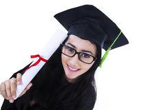 Beautiful graduate holding certificate - isolated Royalty Free Stock Photography