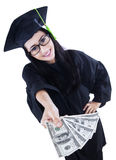 Beautiful graduate holding money - isolated Royalty Free Stock Photo