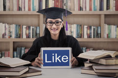 Beautiful graduate show like on touchpad at library Royalty Free Stock Images