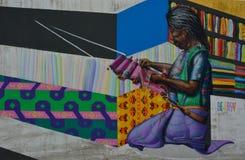 Beautiful grafitti of a weaving woman Stock Image