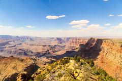 Beautiful Grand Canyon. Panoramic view of a part of the Grand Canyon in Arizona. The Colorado River is meandering through the steep red canyon walls. In the Royalty Free Stock Photo