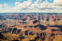 Skyline above the grand canyon. Beautiful Grand Canyon shapes under the sunny sky with shadows falling down from the clouds Stock Photos