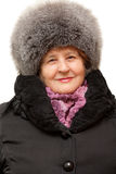 Beautiful grandmother wearing in fur hat Stock Images