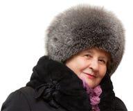 Beautiful grandmother wearing in fur hat Stock Photos