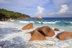 Beautiful granite boulders in Indian Ocean on Stock Photos