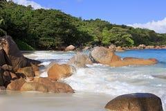 Beautiful granite boulders in the Indian Ocean on Stock Photos
