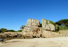 Beautiful granite rocks and house on the beach stock images