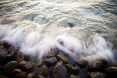 Beautiful granite stones into the sea at sunset Royalty Free Stock Image