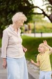 Beautiful granny and her little grandchild together walking stock photos