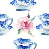 Beautiful graphic lovely artistic tender wonderful blue porcelain china tea cups with lovely pink roses flowers pattern. Watercolor hand illustration Royalty Free Stock Photography