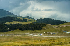 Beautiful grassland is my home. Xinjiang both quiet and natural, fertile vast grassland, another male beauty, steep peaks, glaciers, handsome, charming with Stock Photos