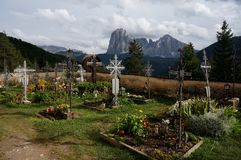 Beautiful graveyard in the mountains with splendid view to distinctiv mountain Stock Photo