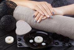Beautiful gray manicure with towel on the white wooden table. spa Stock Photo