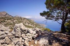 Beautiful greece, wonderful island and sea. Greek mountains on a wonderful island and sea Royalty Free Stock Photo