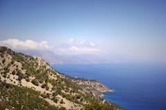 Beautiful greece, wonderful island and sea. Mountains, sky, trees and sea on wonderful island royalty free stock photo