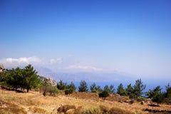 Beautiful greece, wonderful island and sea. Mountains, trees and sea on wonderful island Royalty Free Stock Photos