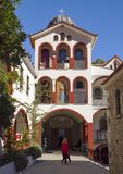 Beautiful Greek church of yellow color on a sunny day in the mountains on an island Evia in Greece stock photography