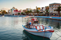 Beautiful greek fishing boat staing parked at harbour of Sitia town on Crete island, Greece Royalty Free Stock Images
