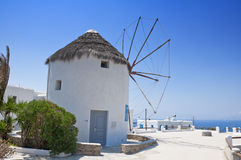 The beautiful Greek island, Mykonos. Mykonos island with whitewash little houses, tiny churches and beautiful old windmills in summertime Stock Image