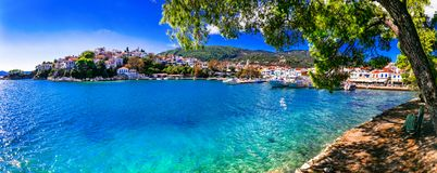 Beautiful greek islands,Skiathos. Northen Sporades of Greece. Beautiful Skiathos island,view with azure sea ,tree and houses,Sporades ,Greece royalty free stock photography