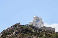 Beautiful greek orthodox church isolated on top of a mountain Stock Photos