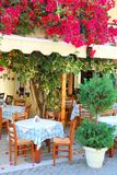 Beautiful greek taverna with bougainvillea flowers Royalty Free Stock Photos